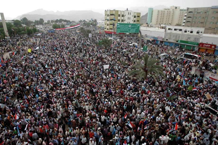 Yemeni supporters of the Southern Separatist Movement hold former South Yemen flags during a rally in Aden, Yemen, on Sunday. The rally commemorates the anniversary of a civil war that broke out in 1986 between South Yemen and North Yemen. Photo: AP
