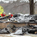 Members of the Colfax, Wis. Fire Department examine charred remains Sunday of St. John's Lutheran Church in the Town of Grant, Dunn County, Wis. A fire late Saturday, Jan. 12 destroyed the nearly 100-year-old rural church located about 10 miles north of Colfax.