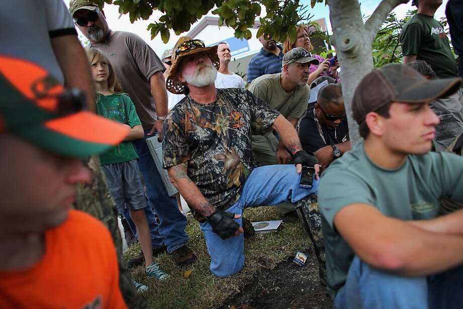Jeff Singleton (center) and others prepare to hunt pythons in the Everglades in Davie, Fla. Photo: Joe Raedle, Getty Images