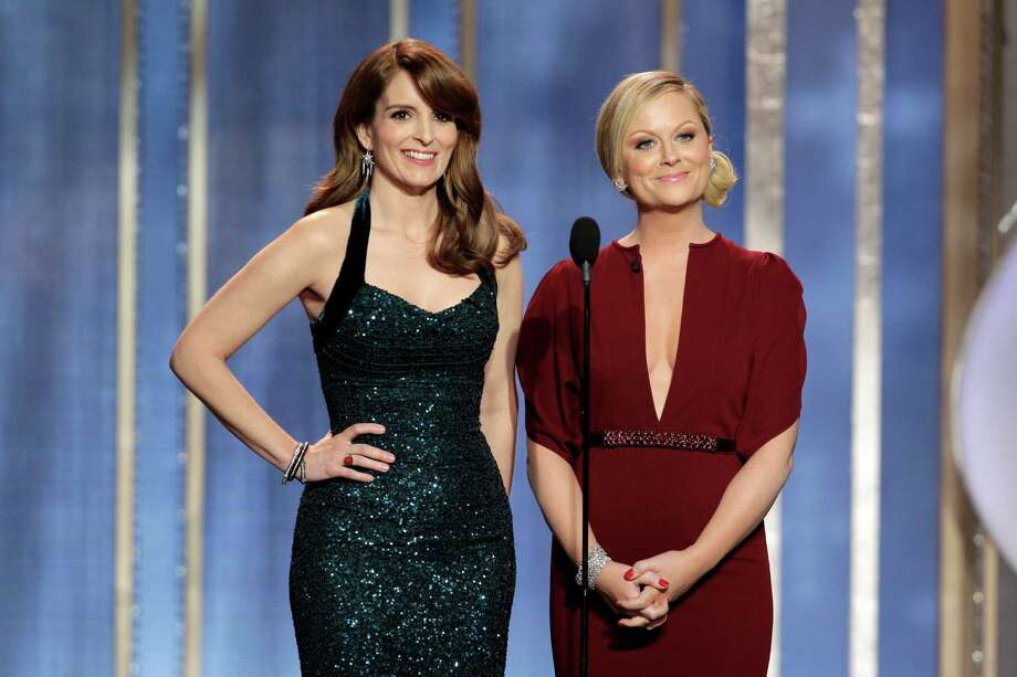 This image released by NBC shows co-host Tina Fey, left, and Amy Poehler on stage during the 70th Annual Golden Globe Awards held at the Beverly Hilton Hotel on Sunday, Jan. 13, 2013, in Beverly Hills, Calif. (AP Photo/NBC, Paul Drinkwater) Photo: Paul Drinkwater