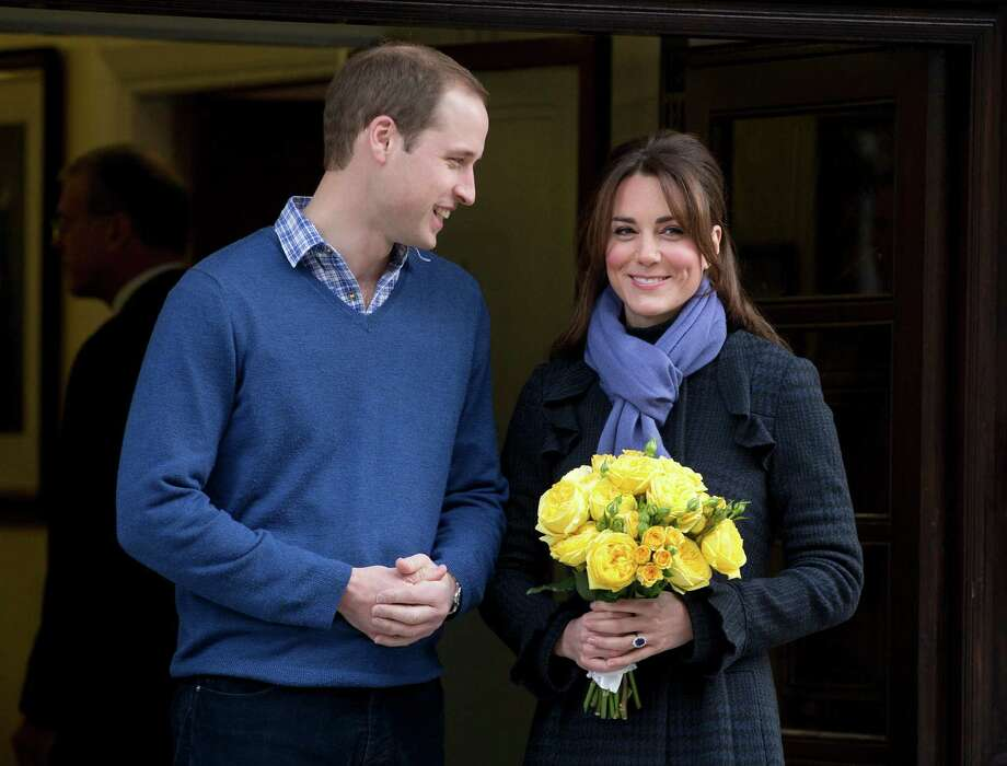 FILE - In this Thursday, Dec. 6, 2012 file photo Britain's Prince William stands next to his wife Kate, Duchess of Cambridge as she leaves the King Edward VII hospital in central London. Palace officials say Prince William and the former Kate Middleton's first baby is due in July and that her condition is improving. (AP Photo/Alastair Grant, File) Photo: Alastair Grant