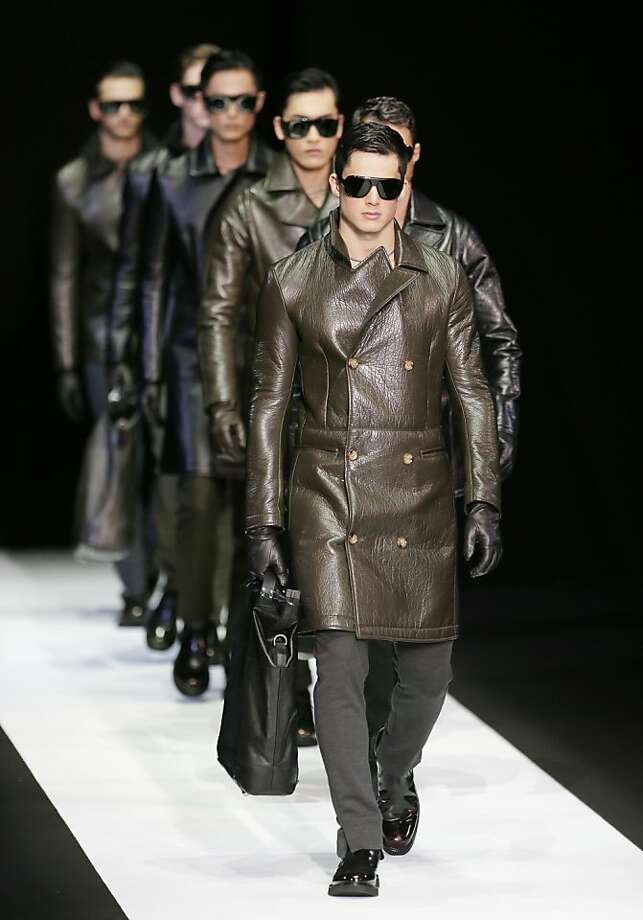 Emporio Armani showed classic silhouettes, like the trench and peacoat, reworked in high-tech fabrics. Photo: Antonio Calanni, Associated Press
