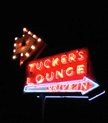The neon sign for Tucker's Kozy Korner on the East Side. Photo: JIM BEAL JR., SAN ANTONIO EXPRESS-NEWS / SAN ANTONIO EXPRESS-NEWS