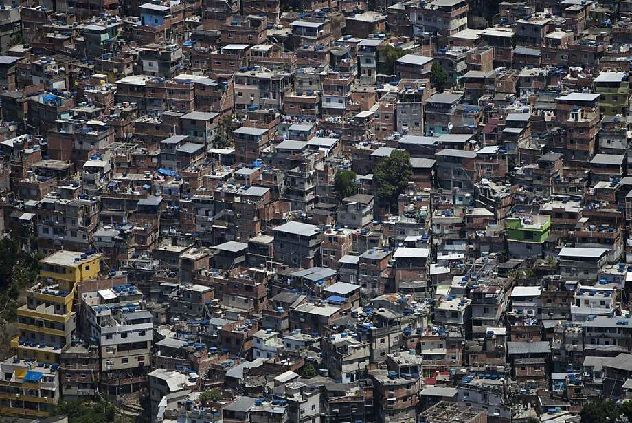 The Rocinha slum in Rio de Janeiro, long a serious problem, shows one of the dangers of overpopulation - although many Rio slums have improved since 2011. Now half the world, including Brazil, is below the 2.1 fertility rate needed for zero growth. Photo: Felipe Dana, Associated Press