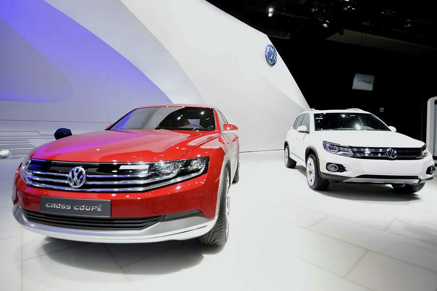 The Volkswagen AG Cross Coupe concept vehicle, left, is displayed during the 2013 North American Int