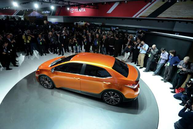 Members of the media view the Toyota Motor Corp. Corolla Furia concept vehicle during the 2013 North American International Auto Show (NAIAS) in Detroit, Michigan, U.S., on Monday, Jan. 14, 2013. The Detroit auto show runs through Jan. 27 and will display over 500 vehicles, representing the most innovative designs in the world. Photographer: Daniel Acker/Bloomberg Photo: Daniel Acker, Bloomberg / © 2013 Bloomberg Finance LP
