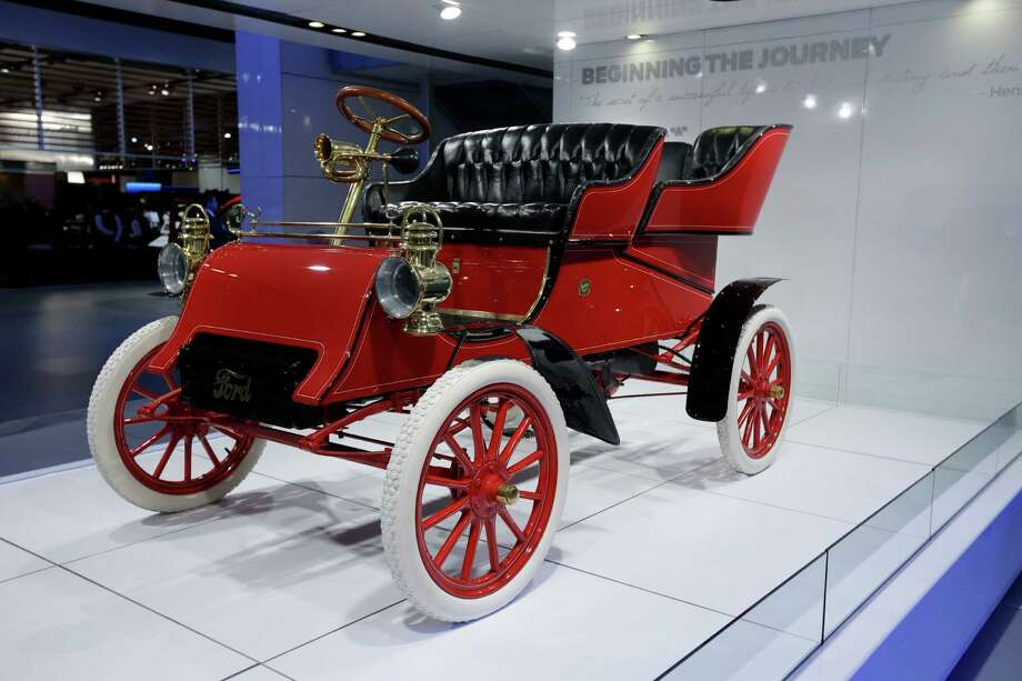 The oldest surviving Ford car, a 1903 Model A is displayed at the North American International Auto Show in Detroit, Monday, Jan. 14, 2013. The Ford Motor Company was created June 16, 1903 and car production started in July. This car is the third vehicle assembled on the first day of production. It was built at the Mack Avenue factory in Detroit and is owned by Ford Executive Chairman Bill Ford. (AP Photo/Carlos Osorio) Photo: Carlos Osorio, Associated Press / AP
