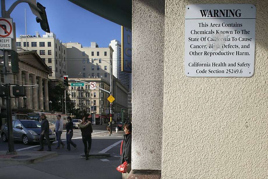 A sign required by Prop. 65 warns about hazards in the parking garage at Fifth and Mission streets in San Francisco. Under the law, nearly 800 chemicals trigger posted advisories. Photo: Liz Hafalia, The Chronicle