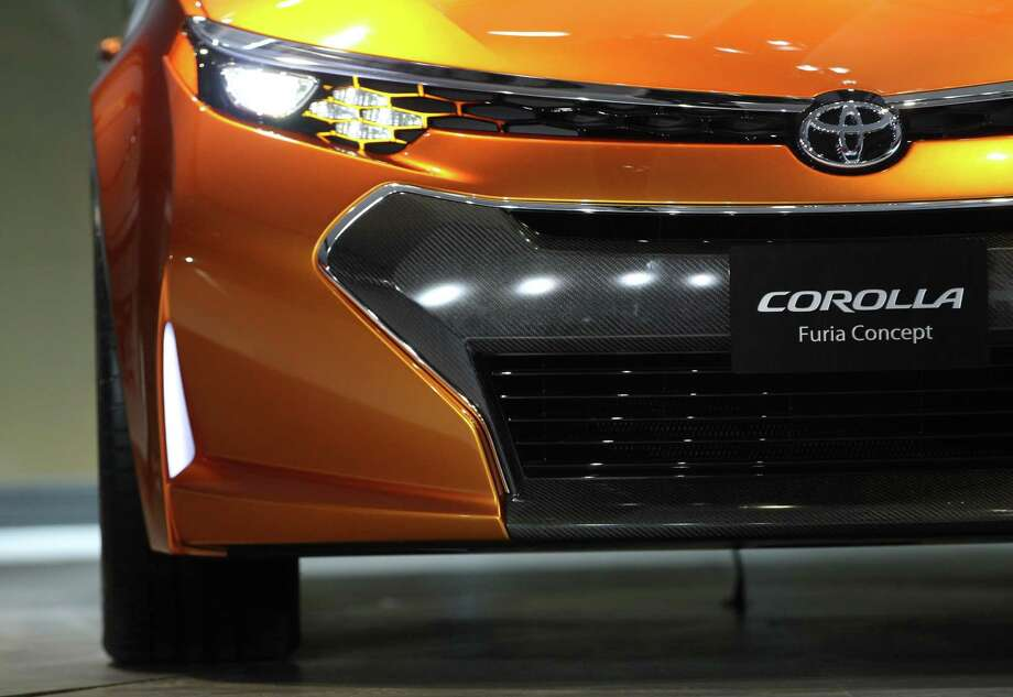 The Toyota Corolla Furia concept car is introduced at the 2013 North American International Auto Show in Detroit, Michigan, on January 14, 2013.    AFP PHOTO/Geoff RobinsGEOFF ROBINS/AFP/Getty Images Photo: GEOFF ROBINS, AFP/Getty Images / AFP