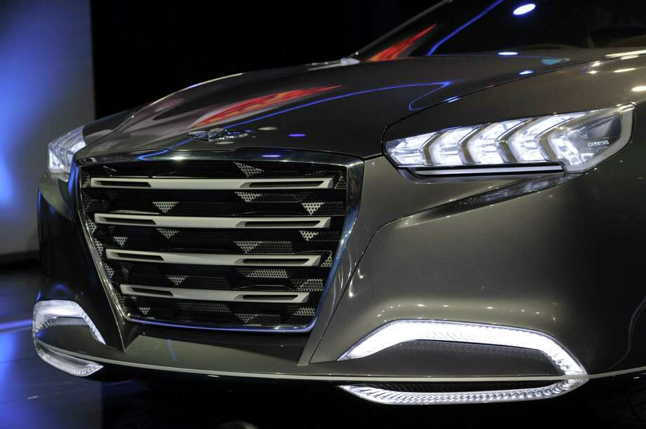The Hyundai HCT14 Genesis concept car is introduced at the 2013 North American International Auto Show in Detroit, Michigan, on January 14, 2013.   AFP PHOTO/Stan HONDASTAN HONDA/AFP/Getty Images Photo: STAN HONDA, AFP/Getty Images / AFP