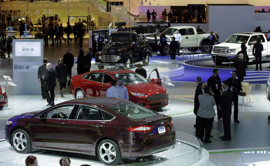 A Ford Taurus is seen in the foreground of the Ford display at the North American International Auto Show in Detroit, Monday, Jan. 14, 2013. (AP Photo/Carlos Osorio) Photo: Carlos Osorio, Associated Press / AP