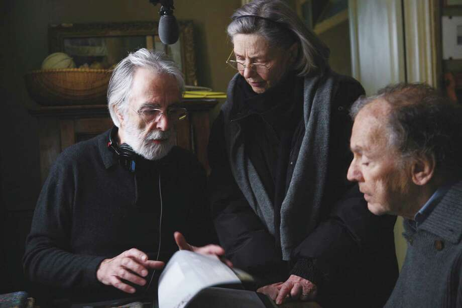 "Director Michael Haneke, left, discusses a scene from ""Amour"" with Emmanuelle Riva and Jean-Louis Trintignant. Photo: Sony Pictures Classics / © Denis Manin"