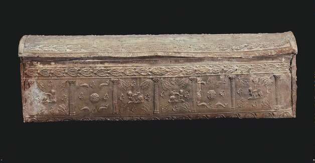 This Roman sarcophagus is decorated with images of sphinxes, dolphins and Medusa heads. Photo: San Antonio Museum Of Art