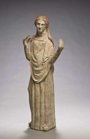 This terracotta figure of a mourning woman is from Italy and dates to the 3rd century BC Photo: San Antonio Museum Of Art / Photography by Peggy Tenison. Contact the San Antonio Museum of Art for Rights and Reproductions.