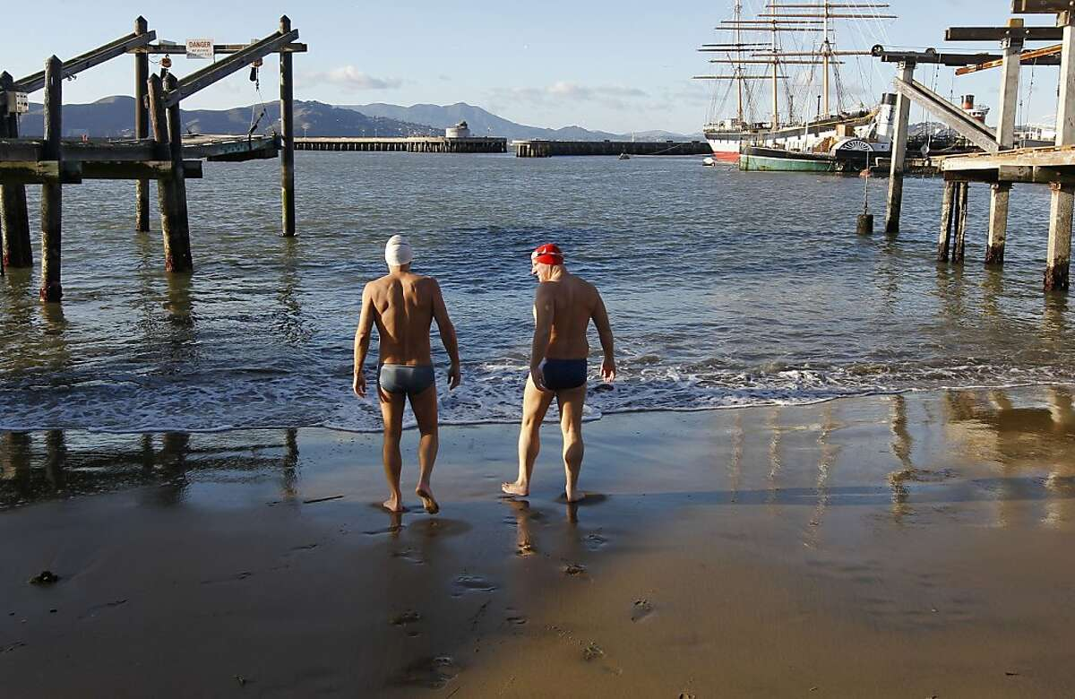 Steve Schatz (left) and Dr. Thomas Nuckton prepare for an afternoon swim off San Francisco's Aquatic Park last week. Both men are members of the Dolphin Club, which encourages swimming without wet suits.