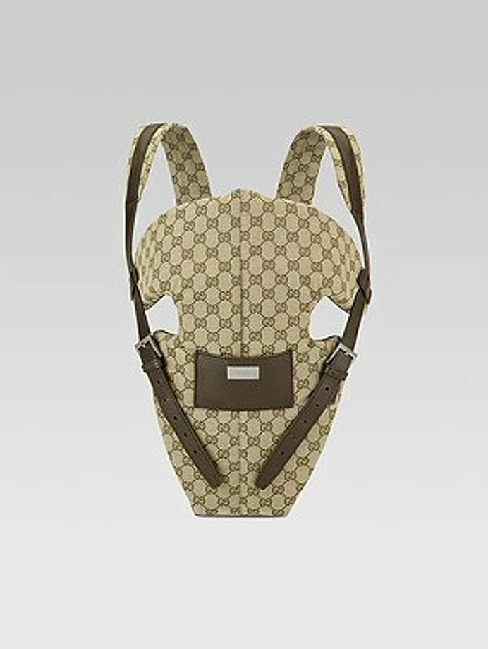 Gucci baby carrier, $820. Carry your baby around in style. neimanmarcus.com