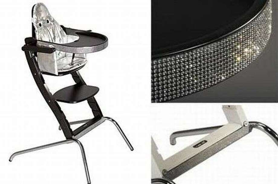 Swarovski high chair, $15,000. This special edition high chair sparkles with crystals on the edge of the tray and at foot of the chair.