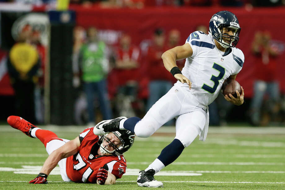 HOMESeattle (11-5)The Texans are also paired this season with the NFC West and so will get their chance to match up with Russell Wilson, who tied the NFL record with 26 TD passes as a rookie. Photo: Kevin C. Cox, Getty Images / 2013 Getty Images