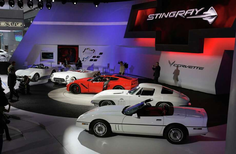 The Chevrolet Corvette Stingray,  in red, is seen with previous models during media previews for the North American International Auto Show in Detroit, Monday, Jan. 14, 2013. (AP Photo/Carlos Osorio) Photo: Carlos Osorio, Associated Press / AP