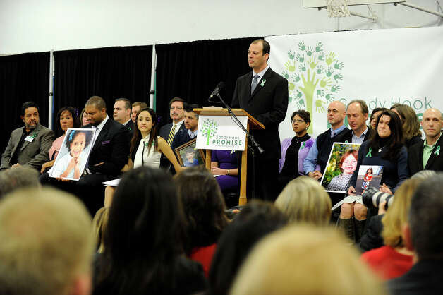 A  Sandy Hook Promise speaker takes to the podium at a press conference held Monday, January 14, 2013, at the Edmund Town Hall in Newtown. Photo: Carol Kaliff / The News-Times