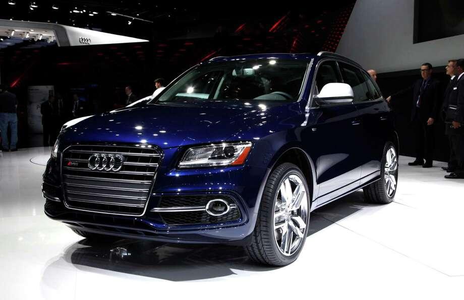 The Audi SQ5 debuts at media previews for the North American International Auto Show in Detroit, Monday, Jan. 14, 2013.  (AP Photo/Paul Sancya) Photo: Paul Sancya, Associated Press / AP