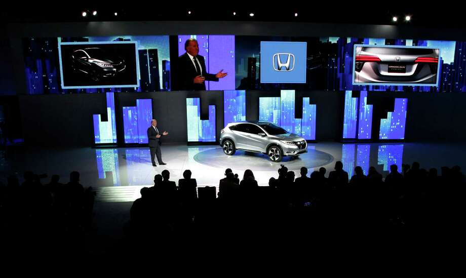 John Mendel, Executive Vice President of Sales,  Honda America, introduces the Honda Urban SUV Concept  at media previews for the North American International Auto Show in Detroit, Monday, Jan. 14, 2013.  (AP Photo/Paul Sancya) Photo: Paul Sancya, Associated Press / AP