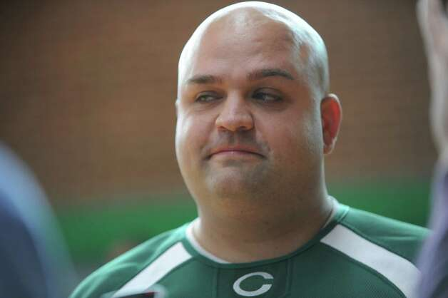 Trinity Catholic High School introduces Donny Panapada, the new football coach, at Trinity, at Stamford, Conn., Monday, Jan. 14, 2013. Photo: Helen Neafsey / Greenwich Time