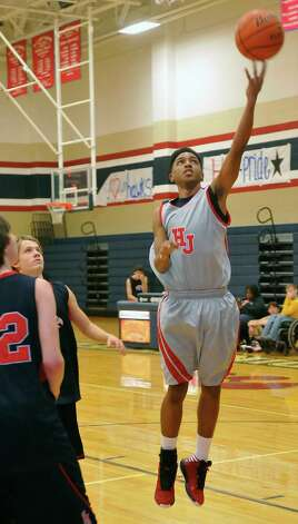 Hardin-Jefferson boys basketball player Devante Johnson, right, looks to shoot the ball towards the basket during Monday's January 14, 2013 athletic period. Johnson is a senior and has helped led the team offensively this season.  Dave Ryan/The Enterprise Photo: Dave Ryan