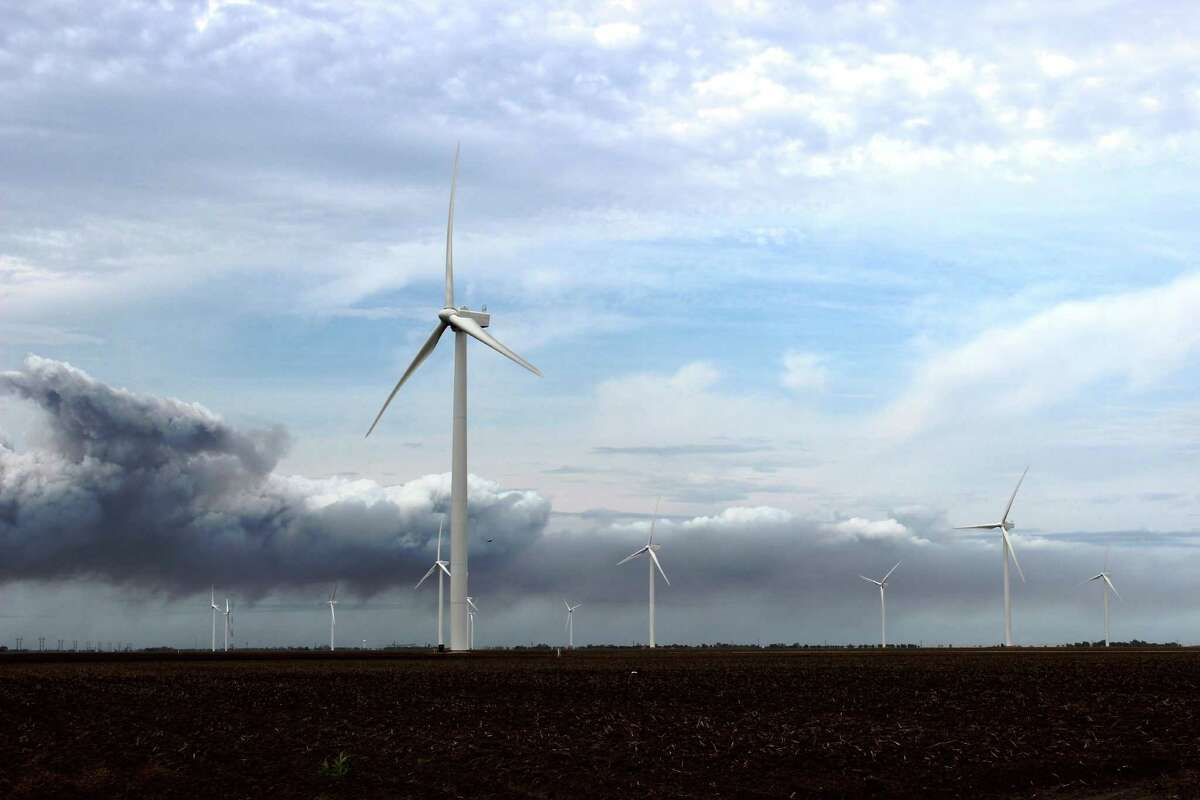 Storm clouds approach Duke Energy's Los Vientos I wind farm in Willacy County on Dec. 30. CPS Energy is buying 200 megawatts of wind-generated power from Los Vientos under a 25-year agreement. Source: courtesy photo / CPS Energy