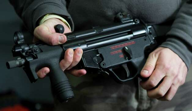 An H&K MP-5K is shown at Houston Armory Tuesday, Jan. 8, 2013, in Stafford. Photo: Brett Coomer, Houston Chronicle / © 2013 Houston Chronicle
