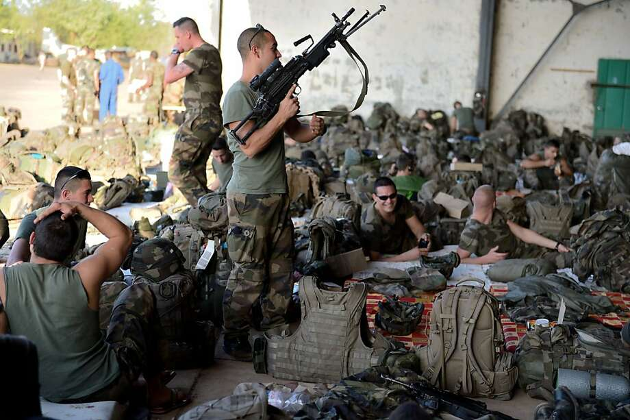 French soldiers rest at an air base after arriving in Mali. The troops are part of a land and air force France has deployed to battle al Qaeda-linked insurgents. Photo: Eric Feferberg, AFP/Getty Images