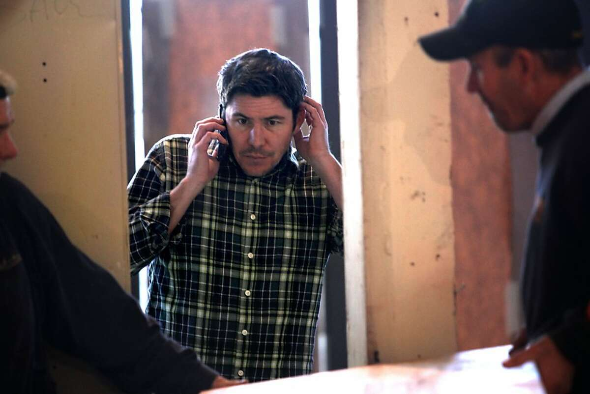 Joe Hargrave (left), who owns the two Tacolicious restaurants in San Francisco, makes sure everything is running smoothly as the Palo Alto site is completed.