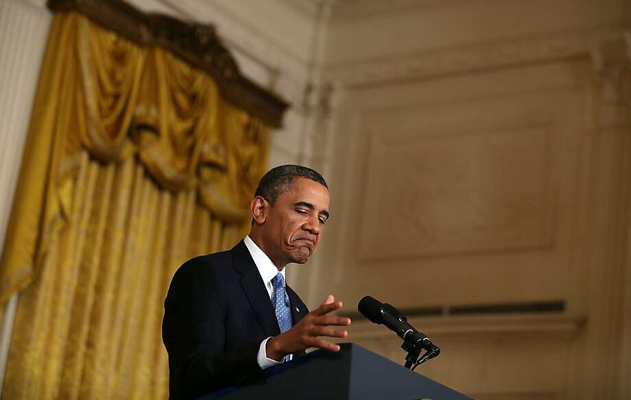 President Obama speaks during a news conference in the White House's East Room. Obama warned of the consequences of failing to raise the debt ceiling. Photo: Alex Wong, Getty Images