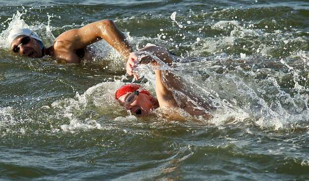 Schatz (left) and Nuckton brave the bay waters. Nuckton, a physician, has been studying his fellow cold-water swimmers. Photo: Michael Macor, The Chronicle