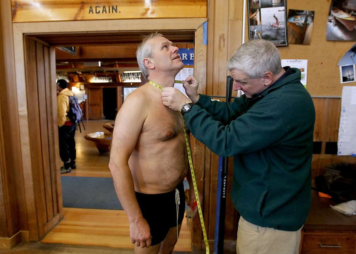 Dr. Thomas Nuckton measures fellow bay swimmer Ralph Wenzel at San Francisco's Dolphin Club. Nuckton recently determined that club members were about the same size as average Americans.