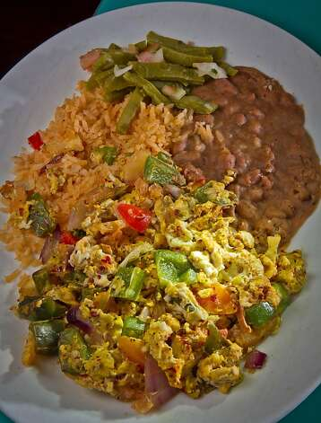Huevos a la Mexicana, like other breakfast items, are served all day. Photo: John Storey, Special To The Chronicle