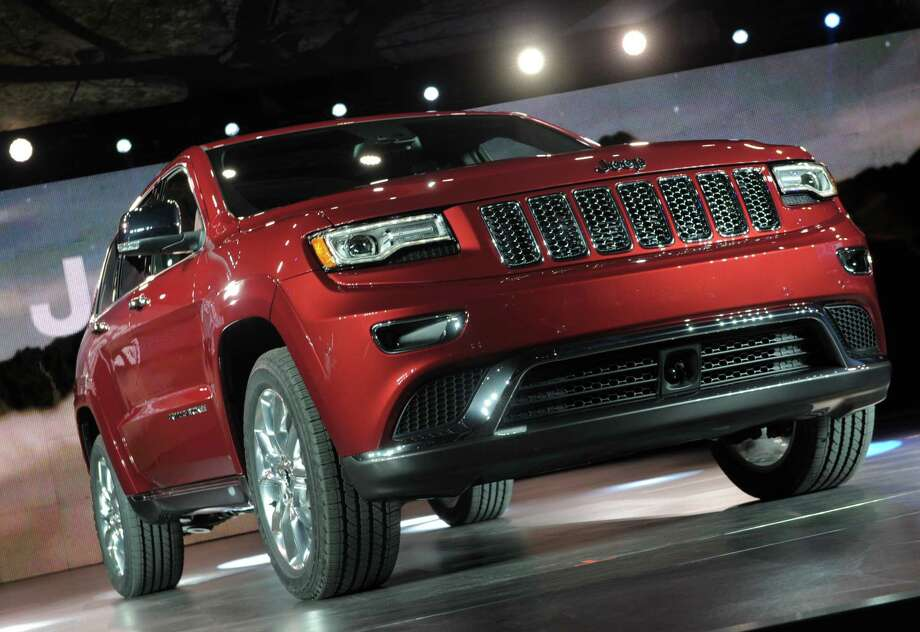The 2014 Jeep Grand Cherokee revised design is introduced at the 2013 North American International Auto Show in Detroit, Michigan, January 14, 2013. AFP PHOTO/Stan HONDA Photo: .