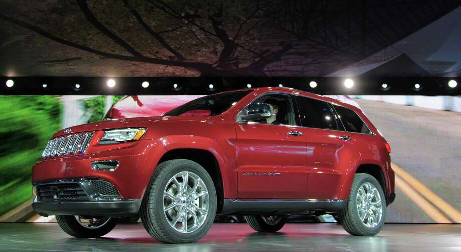 The 2014 Jeep Grand Cherokee is introduced at the 2013 North American International Auto Show in Detroit, Michigan, January 14, 2013. AFP PHOTO/Stan HONDA Photo: .