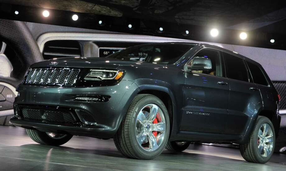 The 2014 Jeep Grand Cherokee SRT high performance version is introduced at the 2013 North American International Auto Show in Detroit, Michigan, January 14, 2013. AFP PHOTO/Stan HONDA Photo: .