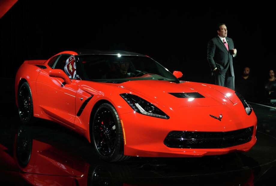 Mark Reuss, President of GM North America, and the redesigned 2014Chevrolet Corvette Stingray introduced the night before press previews start at the 2013 North American International Auto Show in Detroit, Michigan, January 13, 2013. AFP PHOTO/Stan HONDA Photo: .
