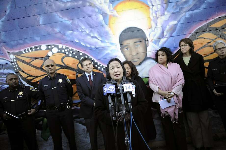Mayor Jean Quan, standing in front of a mural of Carlos Nava, a 3-year-old who was killed by a stray bullet in 2011, speaks on the recent violent crimes in Oakland. The police chief tied many of them to last year's killing of a 16-year-old girl. Photo: Michael Short, Special To The Chronicle