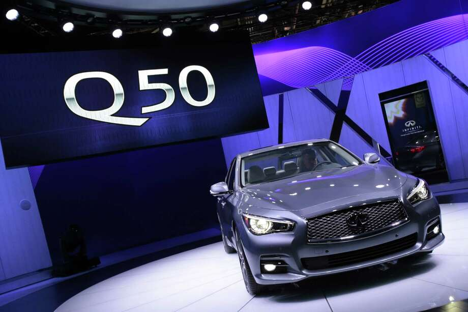 The Infinity Q50 luxury sports car is introduced at the 2013 North American International Auto Show in Detroit, Michigan, January 14, 2013. AFP PHOTO/Geoff Robins Photo: .