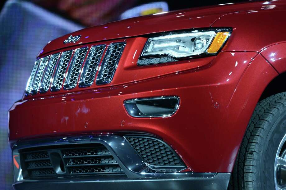 Detail on the 2014 Jeep Grand Cherokee as it is introduced at the 2013 North American International Auto Show in Detroit, Michigan, January 14, 2013. AFP PHOTO/Stan HONDA Photo: .