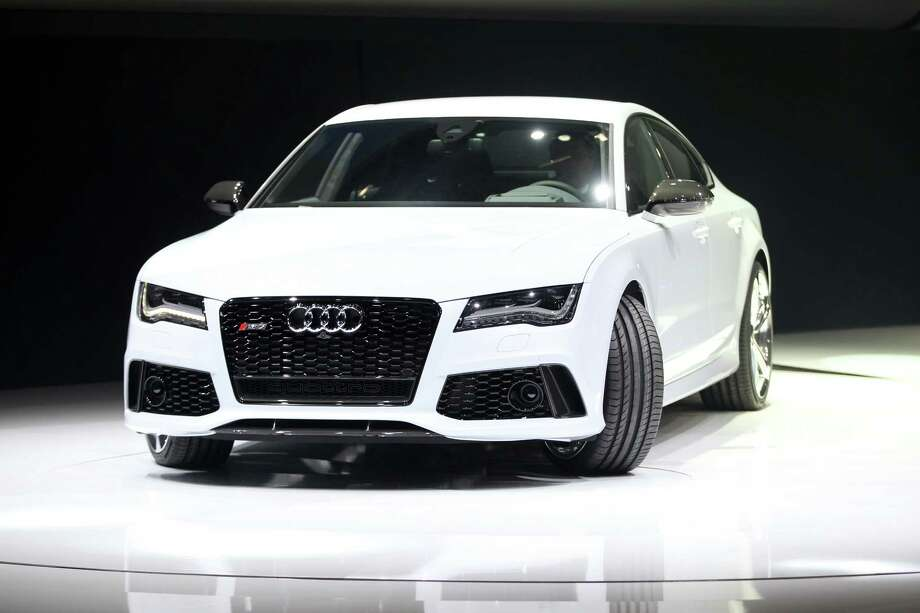 The Audi RS7 is introduced at the 2013 North American International Auto Show in Detroit, Michigan, on January 14, 2013.      AFP PHOTO/Geoff Robins Photo: GEOFF ROBINS, . / 2013 AFP