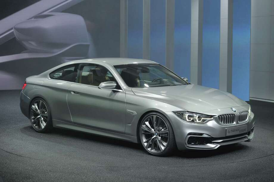 The BMW 4 Series Coupe concept car is introduced at the 2013 North American International Auto Show in Detroit, Michigan, January 14, 2013. AFP PHOTO/Stan HONDA Photo: .