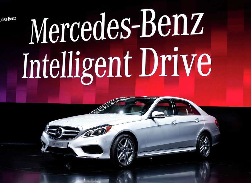 DETROIT, MI - JANUARY 14: The new Mercedes-Benz E 400 Hybrid makes its world debut at the 2013 North