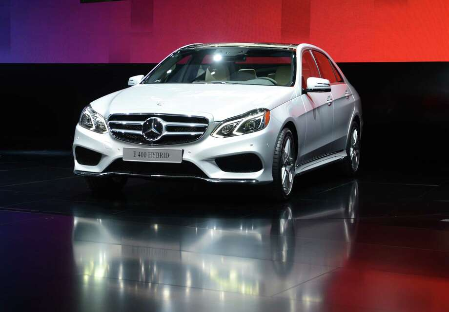 The Mercedes-Benz E-400 Hybrid is introduced at the 2013 North American International Auto Show in Detroit, Michigan, January 14, 2013. AFP PHOTO/Stan HONDA Photo: .