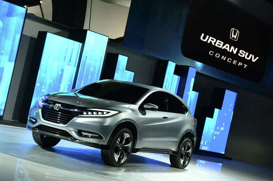 The Honda Urban SUV concept car is introduced at the 2013 North American International Auto Show in Detroit, Michigan, on January 14, 2013.    AFP PHOTO/Stan HONDA Photo: .