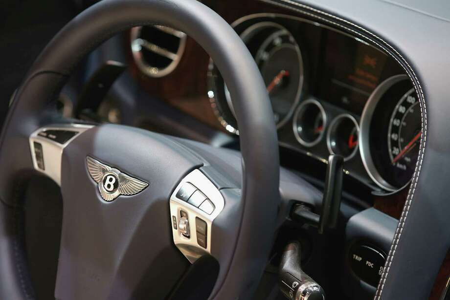 DETROIT, MI - JANUARY 14:  A Bentley emblem graces the steering wheel of the 202 MPH Bentley Continental GT Speed Convertible during the media preview at the North American International Auto Show on January 14, 2013 in Detroit, Michigan. The auto show will be open to the public January 19-27. Photo: Scott Olson, . / 2013 Getty Images