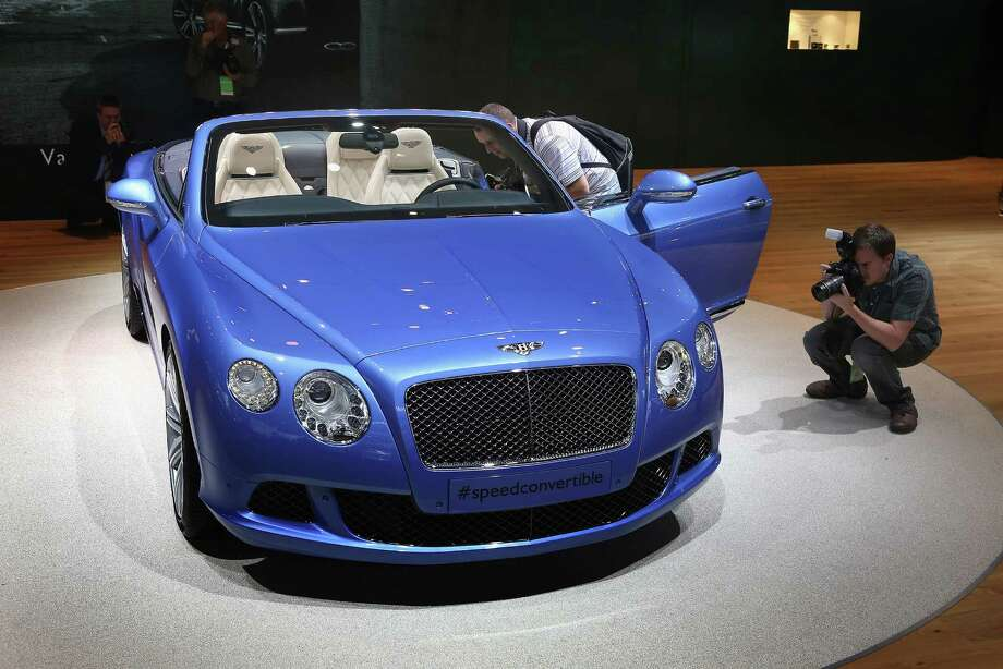 DETROIT, MI - JANUARY 14:  Visitors photograph a 202 MPH Bentley Continental GT Speed Convertible during the media preview at the North American International Auto Show on January 14, 2013 in Detroit, Michigan. The auto show will be open to the public January 19-27. Photo: Scott Olson, . / 2013 Getty Images